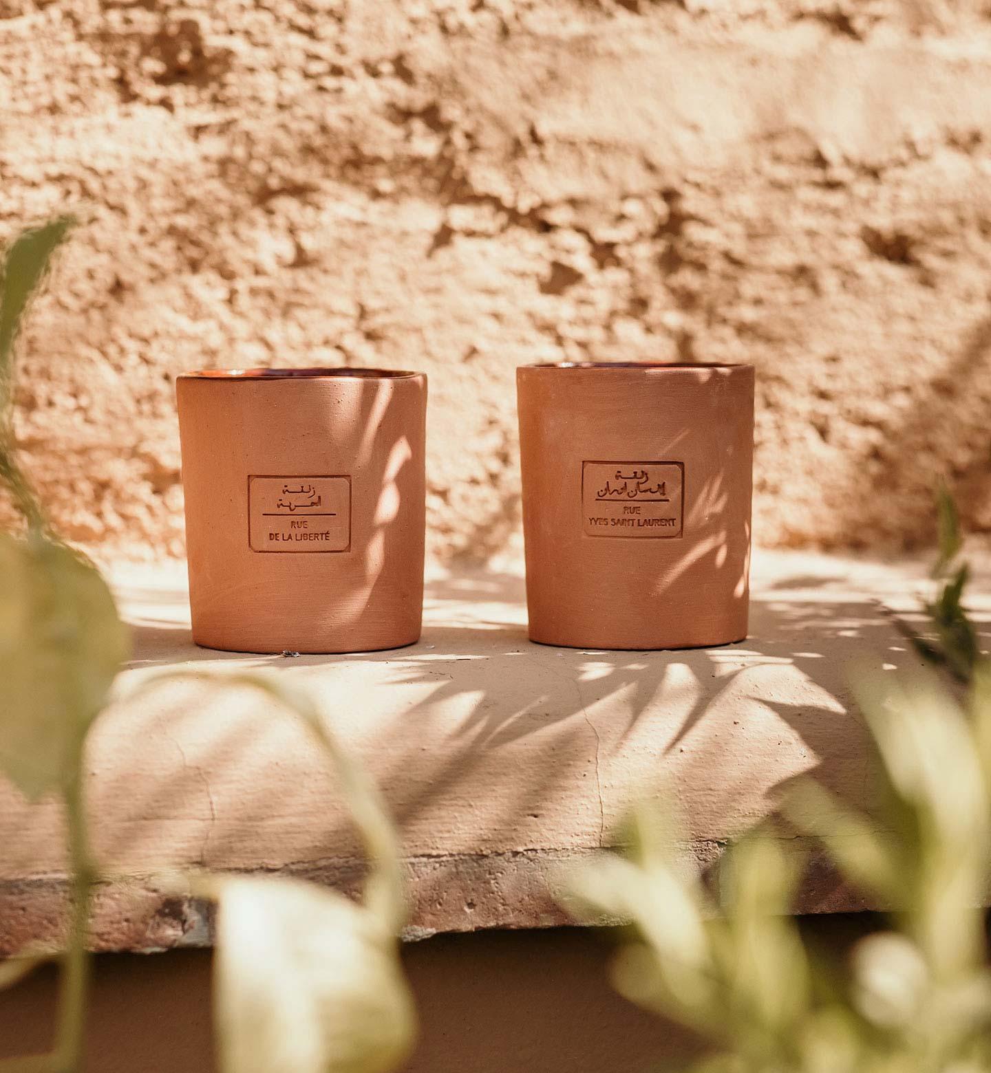 deux bougies de la collection 40000 marrakech en couleur de terre cuite
